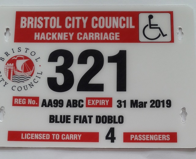 white and red licence plates with black printing