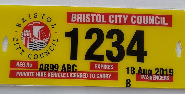 yellow and red licence plates with black printing